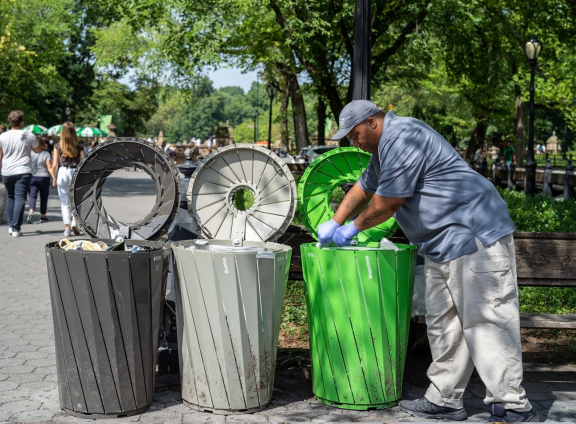 Central Park Trash Cans and Staff