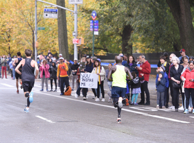 Marathon runners encouraged by onlookers