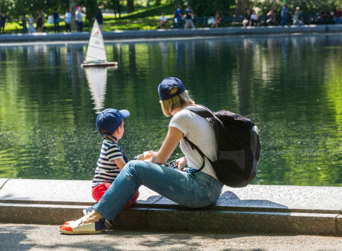 Mother and son watching model boats on Conservatory Water