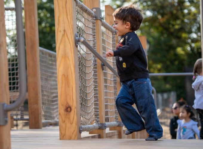 A child enjoys the Kempner Playground
