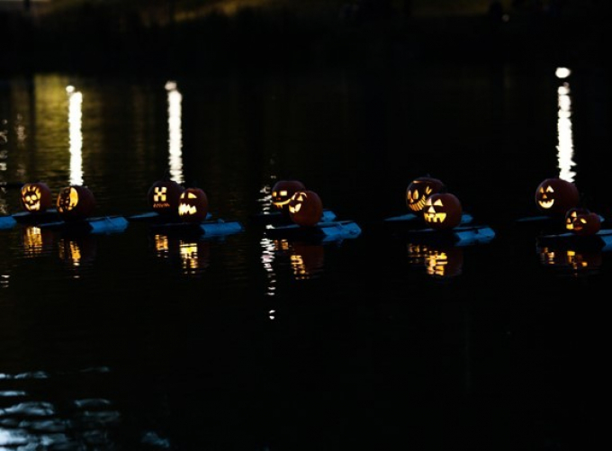 The glowing features of the jack-o-lantern flotilla