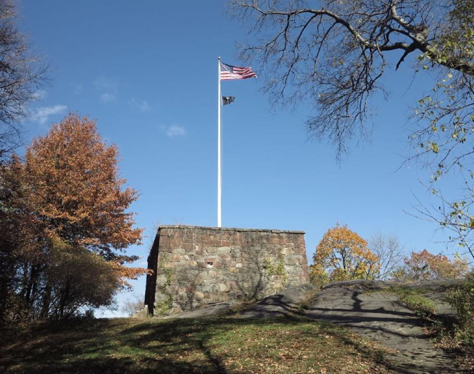 Photo of the Blockhouse against a blue sky.