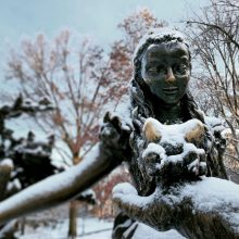 Alice in Wonderland statue in the snow