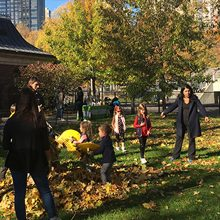 Playground Partners and denizens gathering leaves